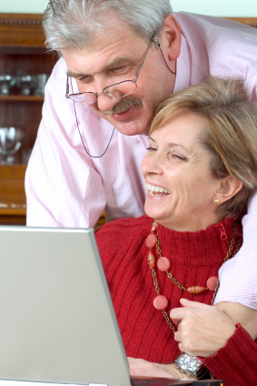 Mature couple working on laptop