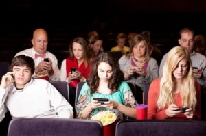 Real People Audience: Adults Teenagers Movie Theater Phone Texti